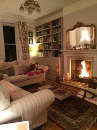 cozy living room with fireplace. Unbelievable Formal Yet Cozy Living Room With A Roaring Fire Favorite Little Pic Of Fireplace Ideas T