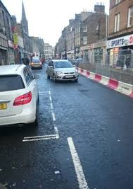 a car driving the wrong way along kirkcaldy high street s west end during roadworks