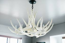 one other image of white fake antler chandelier