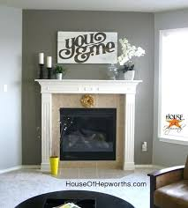 a dramatic fireplace makeover white moulding black mantel black fireplace mantel black painted fireplace mantels black fireplace mantel images black