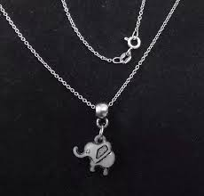 9ct white gold chain with a little jade baby elephant pendant