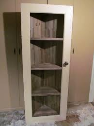 old door into corner cabinet after