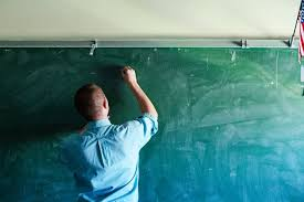 application interview tips teach for america inside tfa · man writing on chalkboard