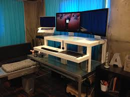 desk mesmerizing standing desk converter for 2 plus keyboard in small home office room with blue curtains in conjunction with dark brown laminated wood