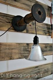diy industrial lighting. diy light from shop and wooden spool or any kind of bracket diy industrial lighting n