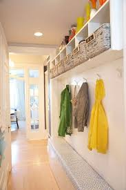 decorate narrow entryway hallway entrance. A Mudroom In Narrow Hallway With Slim Bench, Hooks, And Cabinet Mounted On The Wall. Would Need Open Space Under Bench For Shoes Decorate Entryway Entrance E