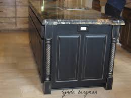 kitchen cabinets painted a satin black then distressed and exitallergy