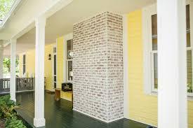 white washed brick fireplace