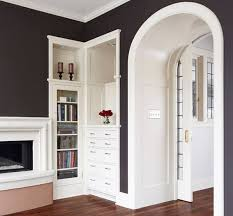 furnitures elegant hallway decor in small bookcase with glass door near small fireplace elegant hallway