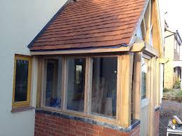 large enclosed glazed oak front porch