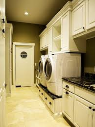 Custom Designed Laundry Room With White Cabinetry And Vanity Black Marble  Countertop ...