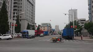 n economy watch foreign direct investment both sides of the street at one of the main intersections in central dandong waiting to go into the customs inspection area to cross into north korea