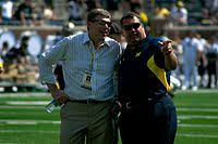Brady Hoke (right) with Michigan athletic director Dave Brandon in 2011.