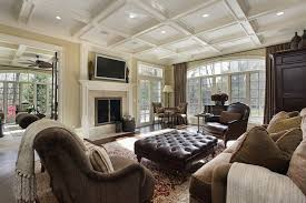 upscale living room design with fireplace in mansion