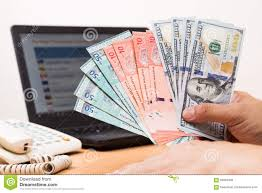 Hand Sorting Malaysia Ringgit And Us Dollar With Computer