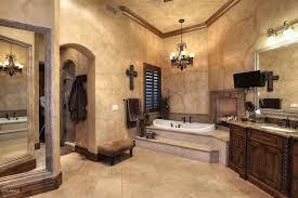 mediterranean master bathroom with chandelier and corner tub