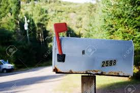 Old Mailbox On A Rural Road With The Flag Up Stock Photo Picture