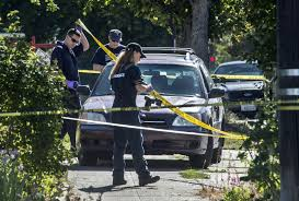 file members of the spokane police department forensics team and major crimes detectives pay close