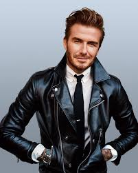handsome david beckham wearing a tie white shirt and leather motorcycle jacket