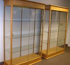 elegant double clear glass display cabinet come with maple wooden frame and also sliding door display