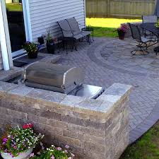 from traditional brick archadeck outdoor living designed and built this unique paver patio and outdoor kitchen combination project