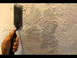 repair a textured wall or ceiling with