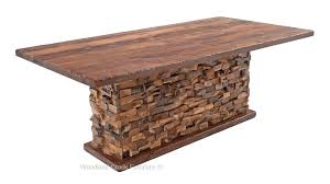 timber frame table with base that resembles stone