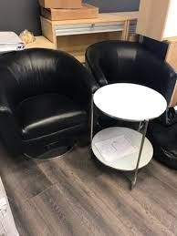office guest chairs swivel black leather with round glass table on wheels