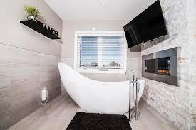 high end bathtubs bathroom contemporary with under cabinet lighting mosaic backsplash wall tiles