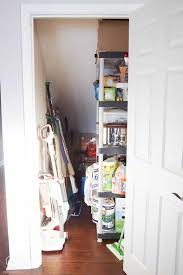 closet under the stairs before small pantry before