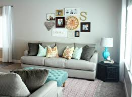 gray walls and a gray patterned sofa allow your family photos to really pop when you hang them in the living room