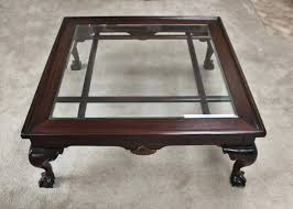 large cherry glass top coffee table with carved claw feet foot small