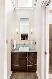 A modern bathroom in a renovated historic craftsman bungalow. Brown stone  ceramic tile, modern  Modern Towel BarsWhite ...