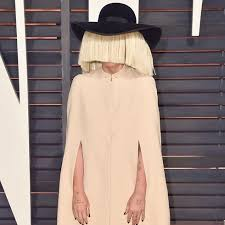 the singer is known for a tendency to hide her face in public appearances photo