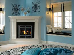 Decorations:Magnificent Corner Fireplace Design In Turquoise Interior Room  With Great Round Rug And Throw