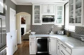 tile kitchen countertops white cabinets. Small Kitchen Designed With White Cabinets And Grey Subway Tile Backsplashes Countertops