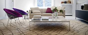 The square tabletop sits flush with the frame and is made of a walnut veneer. Florence Knoll Square Coffee Table Design Within Reach