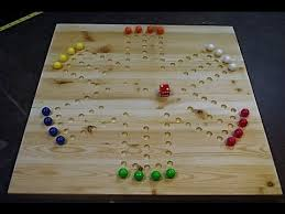 Marble Games With A Wooden Board