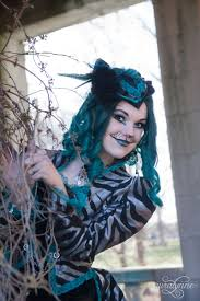 as you can probably see i was inspired by the tim burton version of the cheshire cat for the colors of the outfit the rest of it is straight from my
