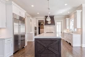 white cabinets with dark brown kitchen hood
