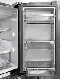 the kitchenaid krmf706ebs s right fridge door features adjule shelves that sit in silvery trimmed holders