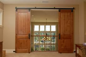 furniture awesome double wooden hanging sliding doors design with black iron fence and beautiful chandelier