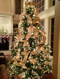 Tulle and burlap Christmas tree. Geez-- I hope we have a tree (