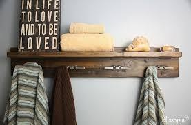 bathroom shelf with hooks for towels
