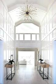 2 story foyer chandelier two story foyer with white so traditional but wait look hang chandelier