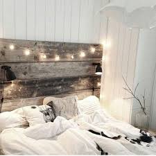 headboard lighting. love the rustic wooden headboard softened by fairy lights lighting t