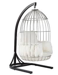 stylized ib arberg hanging birdcage chair parrot