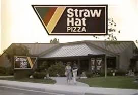 exterior view of a 1980s era straw hat pizza