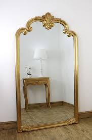 ornate full length mirror with hand
