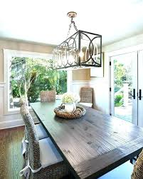 swag chandelier over dining table marvelous how to hang a room at the perfect interior design